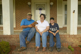 Mom, Pop and Boy-Family Sitting on Front Porch of House in Central Ga on Highway 22 Photographic Print