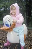 A Preschool Girl Sitting on a Duck Ride Photographic Print