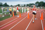 A Female Runner Crossing the Finish Line at the Senior Olympics, St. Louis, MO Impressão fotográfica
