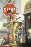 A One-Man Band in a Gold Lame Costume Performing on the Street, Venice, CA Photographic Print