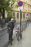 Man Near Parked Bicycle, Paris, France Photographic Print