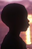 Silhouette of Young Jamaican at Sunset, Negril, Jamaica Photographic Print