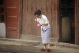 Woman Brushing Teeth Outdoors in Kunming, Yunnan Province, People's Republic of China Photographic Print