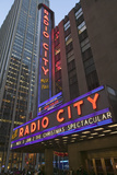 Neon Lights of Radio City Music Hall at Rockefeller Center, New York City, New York Photographic Print