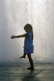 Silhouette of Little Girl Playing in Fountain at Dorothy Chandler Pavilion, Los Angeles, CA Photographic Print