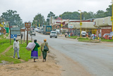 Roadway and Local Zulu Citizens Walking to a Zululand Town in South Africa Photographic Print