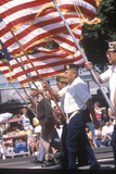Veterans Marching with American Flag in Parade Photographic Print