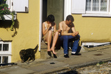 Couple Sitting on Stoop, Norwich, England Photographic Print