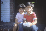 A Mexican Brother and Sister Sitting on their Front Steps, CA Photographic Print