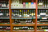 Well Stocked Wine Shelf in Grocery Store in Zululand South Africa Photographic Print