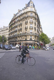 Woman Crossing Street on Bicycle, Paris, France Photographic Print