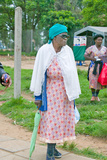 Black Woman with Green Umbrella Walking Through Zulu Village in Zululand, South Africa Photographic Print