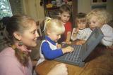 Pre-Schoolers Exploring a Laptop Computer Photographic Print