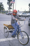 A Senior Citizen Riding a Three-Wheeled Bicycle, Los Angeles, CA Photographic Print