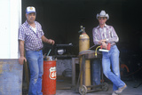 Two Men at an Old Gas Station, Magdelana, AZ Photographic Print
