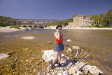 Woman on Cell Phone at the River Gard and the Pont Du Gard, Nimes, France Photographic Print