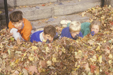 Children in Autumn Leaves Aiming Toy Guns, Westpoint, NY Photographic Print