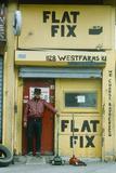 A Repairman at a Tire Shop, South Bronx, Ny City Photographic Print