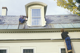 A Couple on Ladders Painting their Home, Nh Photographic Print