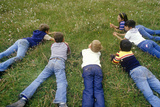 Children Laying on Grass Picking Dandelions,Santa Fe National Forest, NM Photographic Print