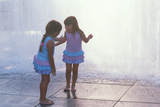 Two Girls Playing in a Water Fountain Photographic Print