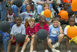 Children Smiling and Holding Balloons at Parade in Central GA Photographic Print
