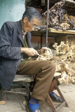 Woodcarver in Marketplace in Kunming, Yunnan Province, People's Republic of China Photographic Print