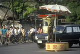 Traffic with Traffic Director in Beijing in Hebei Province, People's Republic of China Photographic Print