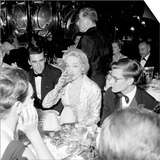 Marlene Dietrich with Yves St. Laurant in Paris at Dinner Table in Restaurant, November 1959 Prints