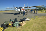 Airplane on Landing Strip Headed to Masai Mara Kenya with Luggage to Be Loaded Photographic Print