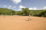 A Tourist Couple Enjoy a Game of Outdoor Tennis at Lewa Downs in North Kenya, Africa Fotodruck