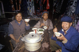 Family Eating Dinner in Dali, Yunnan Province, People's Republic of China Photographic Print