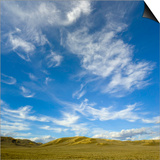 Lofty cumulus and cirrus clouds over sagebrush prairie Posters by John Eastcott & Yva Momatiuk