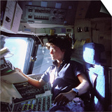 Astronaut Sally Ride Monitors Control Panels from Pilot's Chair of Space Shuttle Challenger Prints