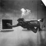 A Scuba Diver Inside a Large Metal Water Tank. Photograph by Heinz Zinram Prints by Heinz Zinram