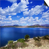 Tranquil Lake Against Cloudy Sky, Sardinia, Italy Prints