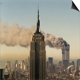 Twin Towers of the World Trade Center Burn Behind the Empire State Buildiing, September 11, 2001 Prints
