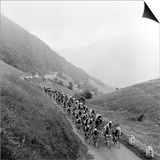 Contestants in the Grueling Tour De France are Seen on Their Way to the Mente Pass Poster
