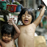 Filipino Children React as They Get a Shower Outside Their Homes Art