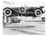 Strong Man Lifting A Car Over His Head Prints