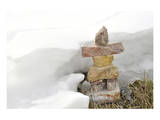 Inukshuk in Cold Winter Scene Posters