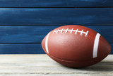 Rugby Ball on Wooden Background Photographic Print by  Yastremska
