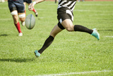Rugby Player Legs Kicking the Oval Ball Photographic Print by  melis
