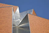 Detail of Aluminum and Brick against Blue Sky. Photographic Print by Barry Winiker