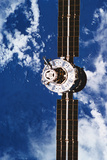 A Satellite Orbiting above the Earth Photographic Print by  Stockbyte