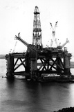 Oil Rigs Photographic Print by Colin Davey