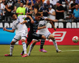 Aug 10, 2014 - MLS: Sporting KC vs Vancouver Whitecaps - Matias Laba, Dom Dwyer, Johnny Leveron Photo by Anne-Marie Sorvin