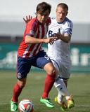 Mar 16, 2014 - MLS: Vancouver Whitecaps vs Chivas USA - Erick Torres, Jay DeMerit Photo by Kirby Lee