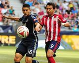 Jul 12, 2014 - MLS: Chivas USA vs Vancouver Whitecaps - Erick Torres, Johnny Leveron Photo by Anne-Marie Sorvin