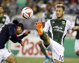 Aug 16, 2014 - MLS: Portland Timbers vs New England Revolution - Lee Nguyen, Gaston Fernandez Photo by Stew Milne